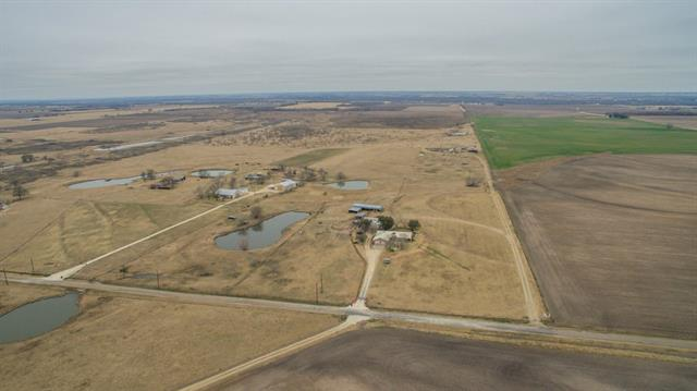 beautiful usable land with a view for miles.  Only 6 minutes to Thorndale or 25 minutes to major shopping areas. Does not have to be a weekend place this is a easy commute to Austin with various routes into Elgin, Manor, Georgetown and Taylor.  This carries a D1D Ag exemption for low taxes.  Water and Electric to the property so you can build your dream home.  If you are looking for seclusion and privacy this 126.042 and the front 4.93 gives you a total of 130.97 Acres to roam and call home.