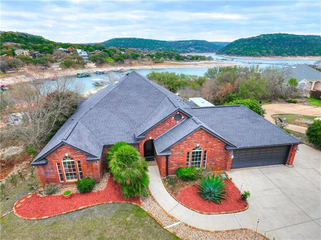 Stunning Lake Travis waterfront retreat w. amazing views on approx 2 acre. Only 10 min from Four Points & 40 min from DT Austin*Boat Dock w. electric boat lift & composite decking**Dual jet ski dock w. electric lift*25 x35 workshop/boat storage w. 9 x 34 Hydraulic door*7 x 15 Swim Spa/Hot tub*Far infrared Sauna*Gorgeous Master Spa w. double vanity, 2 walk-in closets, separate shower & tub**Kitchen w. granite counters SS appliances*Study w. lots of built-ins*Beautiful manicured backyard*Vandergrift High S.