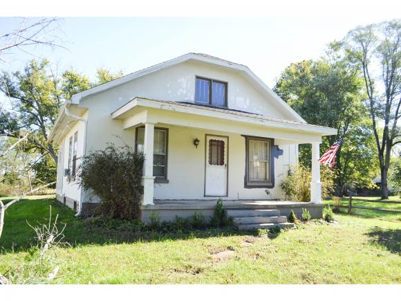 Cute 2 bedroom home on 2.66 acres.  Nice woodwork; living room, dining room, kitchen, laundry on main level.  Covered front & back porch.  Unfinished second floor could make 3rd bedroom.  Parking in rear with carport.  12x20 shed.  Room for a garden.