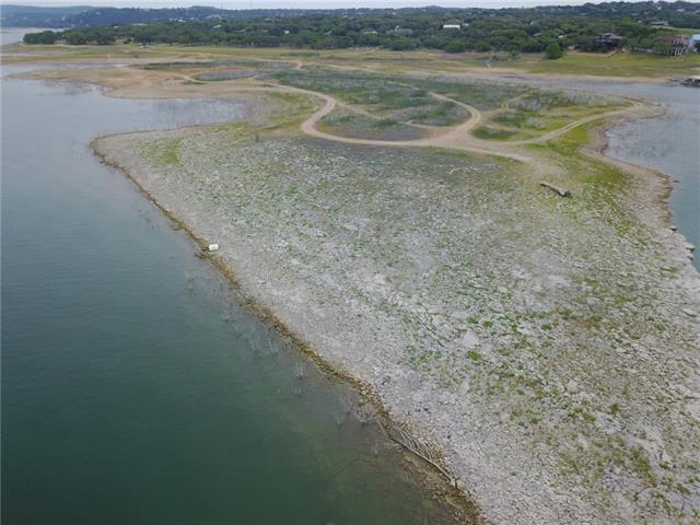 Was future site for Phase 2 of The Island on Lake Travis. Aprox 1,250 Feet of shoreline at the 670' lake elevation. Property comes with (18) 30' covered boat slips at the Island Marina. Additional property in front at 3904 Lake Park Cv included for road access. Potential development could be as condo resort property, hotel, mixed use, or private waterfront estate. Will have to build up due to flood plain. Should be able to receive all utilities from City of Lago Vista. Call agent for private tour.