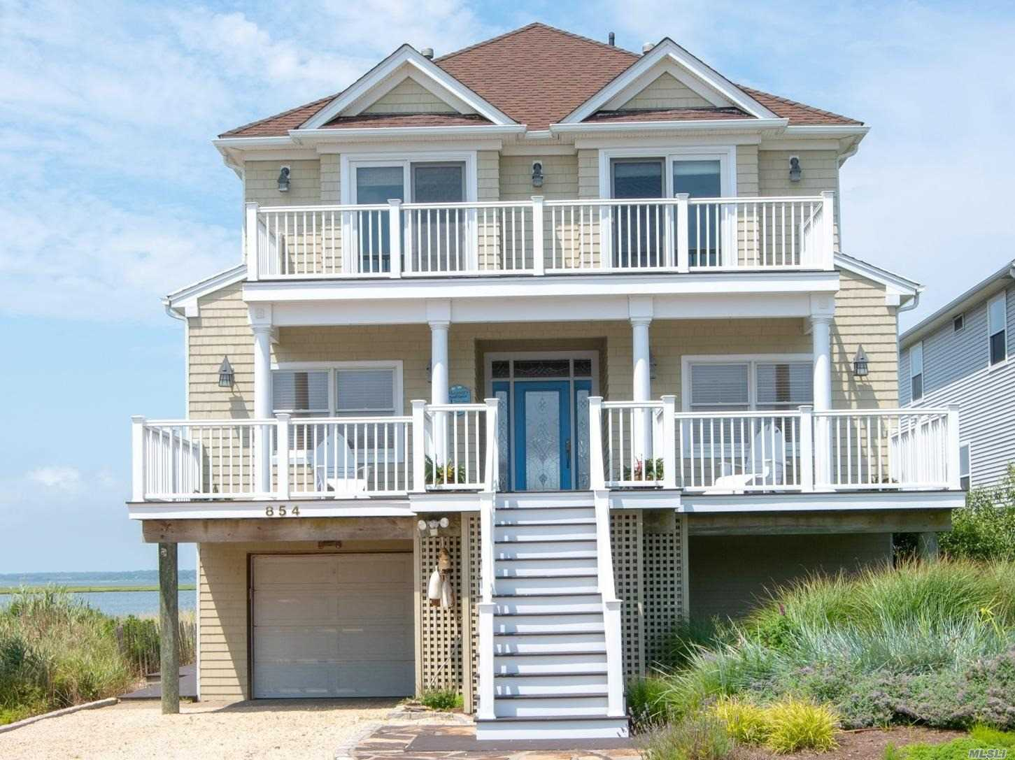 This 6 Bedroom, 4 Bath Beach House Includes Both Jr. & Master En-Suite Bedrooms, Den/Family Room, Oversized Eat-In Kitchen W/Island, New Stainless Steel Appliances And Cabinets, New Wood Floors On 1st & 2nd Floor, Formal Living Room, 3rd Floor Loft/Office. Oversized Front Porch And Extensive Decking Overlooking Moriches Bay To Watch The Breathtaking Sunsets! Ocean Access Steps Away!