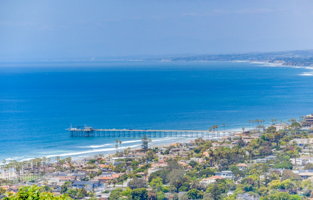 Reduced! Seller will entertain offers between $2,999,000-3,388,000. Panoramic ocean view! Located on the hillside high above La Jolla Shores, this beautiful recently remodeled contemporary home has panoramic ocean and whitewater views along north shore and expands to mountains. Located in a quiet cul-de-sac, this gorgeous home Offers 4449 sqft, 4 bedrooms and 4 baths, cherry wood and granite flooring, cathedral ceilings, pool size backyard and view balconies. Fabulous chef kitchen! Please see supplement.Great location, great view! 3 bedrooms and 2 baths on the main level. Walk up to the mezzanine level where the living room and formal dinning sits overlooking the beauty of the La Jolla Shores. Lives like one story since the master bedroom and laundry room is on the same level as all the living areas except the three secondary bedrooms. Fabulous chef kitchen includes Sub zero refrigerator and wine coolers, 8 burner Viking Range and two ovens, large island and skylights. There are many windows and walls of glass! This home filled with natural light.