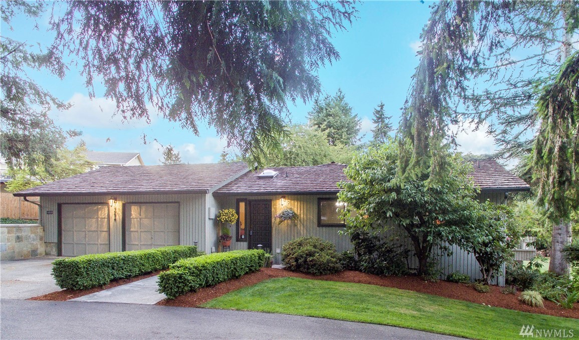 Updated Rambler on almost an acre, minutes from Microsoft, walk to Marymoor Park.Cascade views & conveniently located with easy freeway access.Enter into a stunning gourmet kitchen w/slab granite counters, SS apps, oversized sliding doors to the deck. Handicap MIL boasts separate entry, updated bath, kitchen, 4th bed with private lanai.Easily add another level to this home, structurally ready for 2nd story.Zoned R4, potential for 3 large lots,utilities in street.The possibilities are endless!