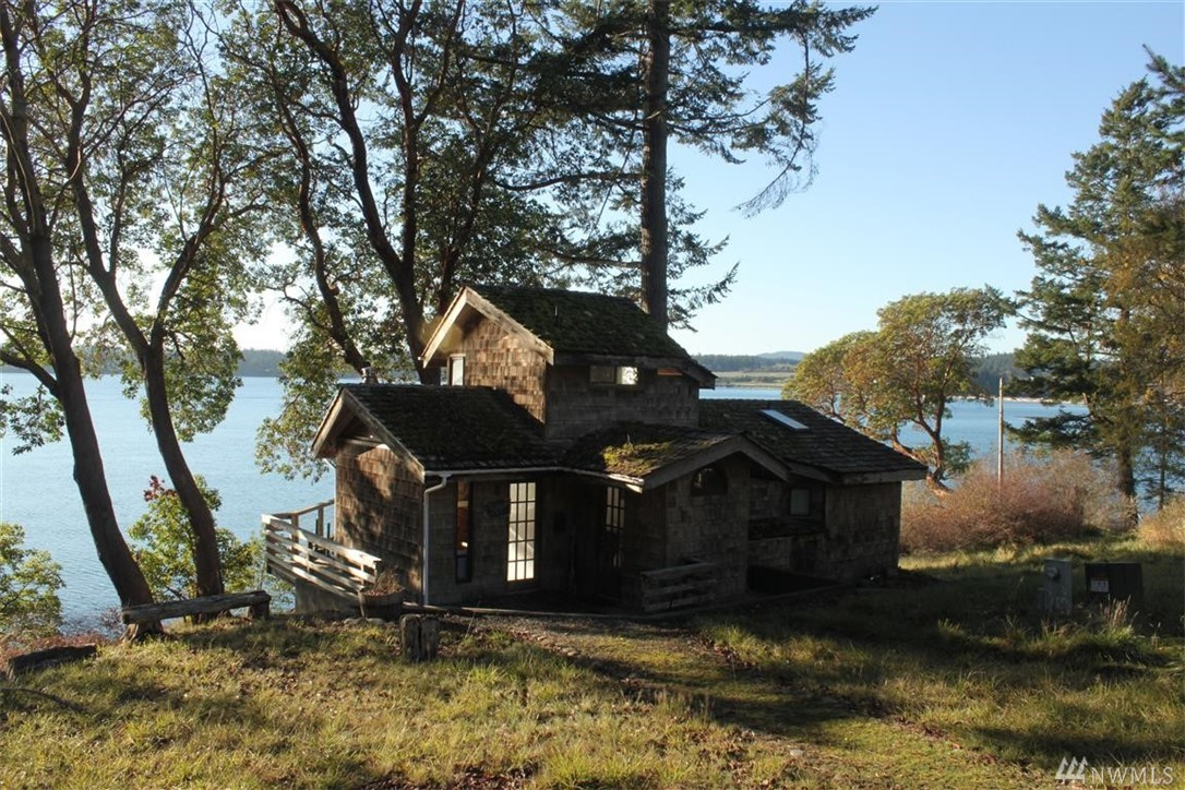 Very rare opportunity to own 3 parcels on Pear Point of which 2 are waterfront parcels with roughly 1,379 of combined waterfront!!  Parcel #352411007 has a private well which produces 3 GPM and has a 3 bedroom septic system and there is a very modest cabin and barn with a loft.  Parcel # 352411009 has amazing water and island views and many great building sites, it  looks over parcel #352411010 which is a community beach front parcel shared only between the other two parcels.