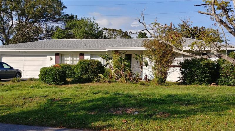 SPACIOUS BLOCK HOME ON A NEIGHBORHOOD PARKWAY! This 2 bedroom 1.5 bath block home boasts an oversized master bedroom, a Florida room, an oversized 2 car garage with washer/dryer hookups, an oversized fenced yard, and a new roof. Good schools, good area, good opportunity.
