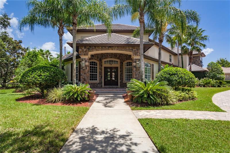 Located in the Highly sought after Gated Golf community of Alaqua Lakes on an OVERSIZED corner home site. Freshly painted inside & outside this outstanding Beauty has 5 true bedrooms, 6 Bathrooms, Office & a Home Theater/Bonus Room.  Upon entry you will see the Brand New Hickory Engineered Hardwood flooring throughout the entire first floor along w/the unobstructed pool & yard views, Living Room just the right size w/new French doors & Dining Room.  Recently upgraded Gourmet Kitchen w/Granite countertops & Island opens to the Eat-In Kitchen Nook & Family Room w/Built-In Entertainment Center & NEW French Doors leading out to the Swimming Pool. Spacious Master Bedroom w/Pool views, Recently Renovated Master Bathroom & 2 walk-in closets. Upstairs you'll find 4 additional Bedrooms, one with its own bathroom & the other a Jack & Jill, a loft area perfect for the kids & an expanded Theater/Bonus Room w/full bathroom. Home features App controlled Nest Thermostats throughout & App controlled front & side door locks.  Step outside to a Private Fenced yard you will find a Large Crystal Clear Salt Water Swimming Pool w/LED lighting, Heated Spa, Travertine Paver Patio Deck, Summer Kitchen & Lush Tropical Landscaping.  A rare 4 – Car Garage w/App controlled NEW Woodson Garage Doors and a NEW Paver Circular Driveway and AMAZING curb appeal.  Community Features a Tom Fazio designed Golf Course, Club House, 7-acre park w/ a Community Pavilion, Pool, Tennis Courts, Beach Volleyball Court, Ball Fields & Basketball Court.
