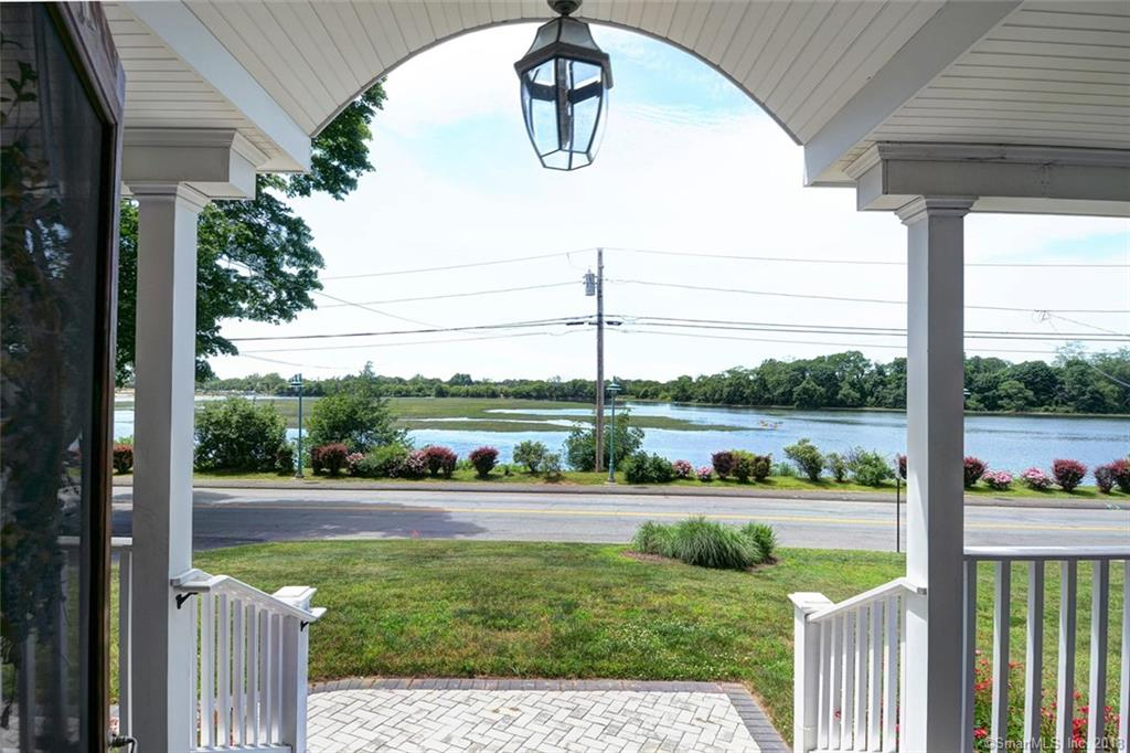 A rare find in the highly desirable neighborhood of St. Mary's By The Sea where sunrises and sunsets are enjoyed daily, w/unobstructed waterviews, from the front porch and from 3 sides of the interior of this charming well maintained Cape Cod.  Ideal for entertaining with a formal dining room w/built-in hutches, living room w/fireplace, eat-in kitchen & enclosed breezeway with access to terraced patio and landscaped yard and of course, a fantastic covered front porch. This light filled 1940's vintage home consists of: 3 Bedrooms (1 on the main level), 2 Full Bathrooms (1 on ea. level), full Basement., 1 car attached Garage, Hardwood Floors (tiled floors in both bathrooms and kitchen), central A/C and security system. Move-In Condition NOT IN FLOOD ZONE - NO INSURANCE REQUIRED Walk To everything: the train station, shops, restaurants, library