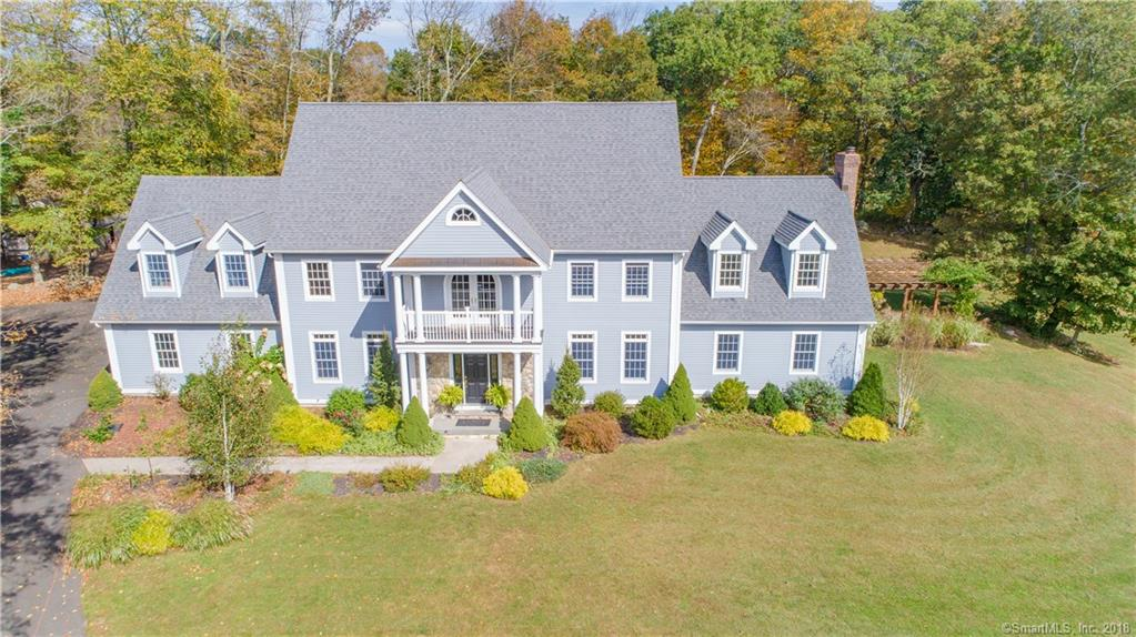 Located in one of Fairfield County's best-kept secrets in Newtown, CT, this striking Colonial is sure to please and accommodate! Situated down a private driveway, it has a spacious level lot with the perfect mix of sun and shady trees adorning the property. Perfect for hosting family gatherings and recreational activities on a sunny day. The gourmet cook in the family will feel right at home in the modern kitchen. Lovely hardwood floors throughout, cathedral ceiling, fireplace and spacious rooms are just the beginning of all this marvelous home has to offer. The patio and porch offer beautiful outdoor living options and gorgeous New England wooded views. Very close to shopping; strategically located between 84 and 95 for an easy commute.