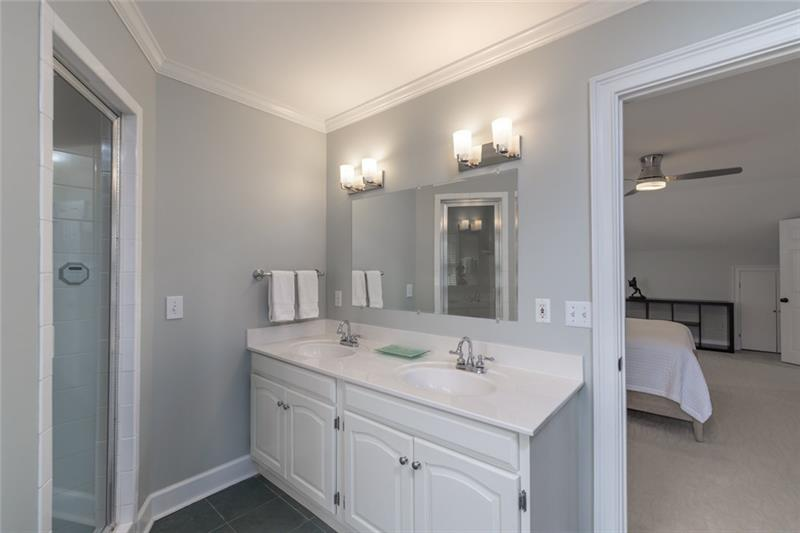 Add'l views of full upstairs bath, boasting double vanity, large walk-in shower & garden tub!