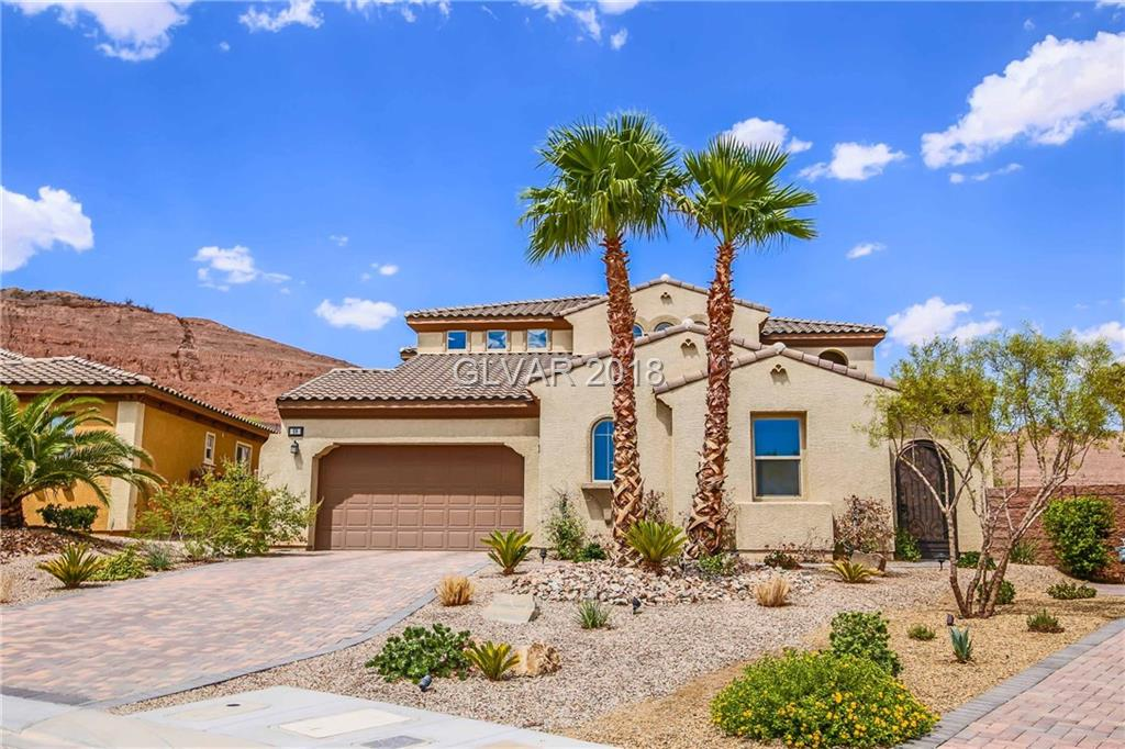 Best price per Sf Value in all of Lake Lake Vegas! Situated on one of the highest points in Lake LV w/in the gates of Tremezzo. Perched on a premium oversize lot, stunning views of mountains, a beautifully landscaped rear yard w/ Jacuzzi & paver patio. Courtyard entry,dramatic sweeping staircase, stunning formal dining, large den, magnificent kitchen,1st floor guest suite, spacious loft, amazing master suite boasts balcony & dual walk-in closets!