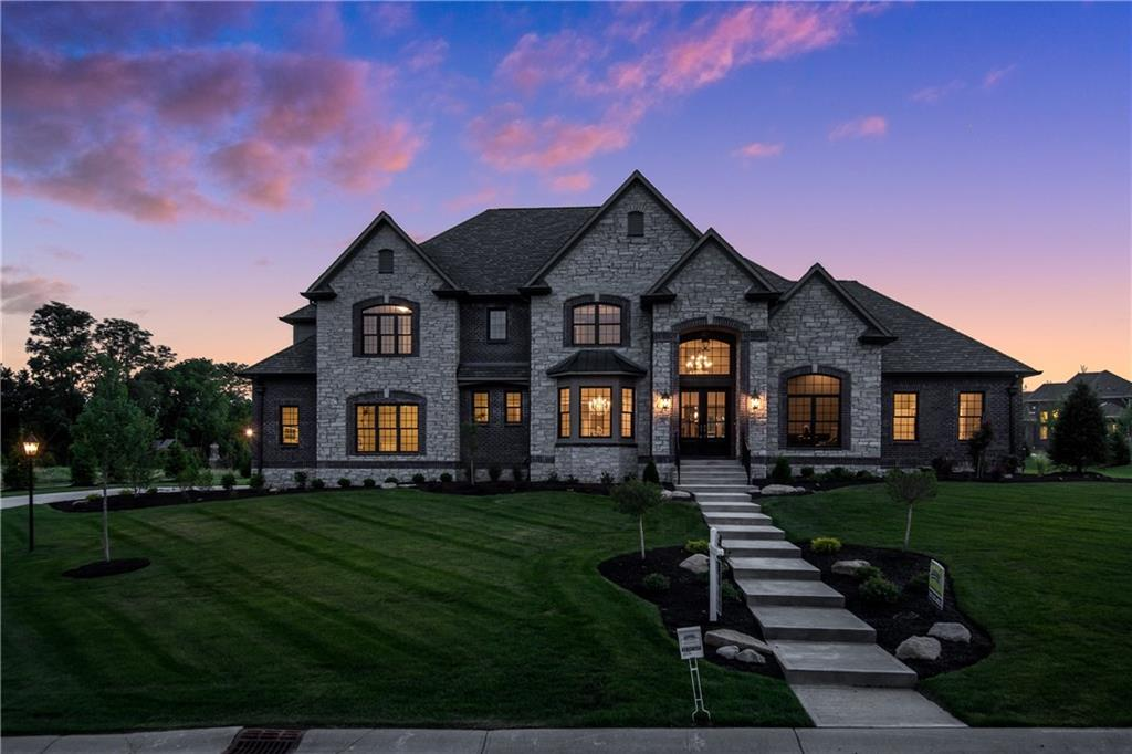 "One of Coronado's FINEST. Truly a must see... Located in SW Zionsville's Luxury Estate Community & SOON TO BE FULLY GATED  'Oldfield' this hm features the highest of finishes throughout. Main flr master bedrm/suite w/ a sitting rm & a WOW factor bathrm, Exquisite Thermador chefs kitchen w/ 2 paneled door refrigerators w/ freezers below, 48"" pro series range w/ double ovens, warming drawer & steamer--high capacity venting to outside. Finished lower lvl w/ a huge kitchen connected to theatre area & sitting rm w/ fireplace. 4 Car heated garage w/ epoxy flooring, commercial grade quiet dr garage door openers. Energy star 92% high efficiency HVAC systems upstairs and down. All with a gorgeous stone/brick exterior elevation situated on .92 acre"
