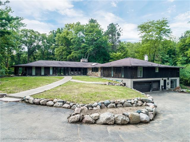 An opportunity of a lifetime - 5.2 wooded private acres on Wing Lake Rd in Bloomfield Hills showcasing a stylish vintage home designed by renowned architect James W Conn. James studied under Frank Lloyd Wright and Eero Saarinen and was on the esteemed architectural team that designed the St Louis Arch. For the first time ever this spectacular property is now available to you. The home boasts 8 bedrooms, 4.2 bathrooms, floor to ceiling windows that frame stunning views, natural stone fireplace with adjacent wet bar, private master suite, walk-in closets, built-in storage,and walkout lower level with bedrm, bathrm, and rec rm. Extensive hardscaping installed in 2017. Enjoy having the endless picturesque views and amusing wildlife all to yourself or take advantage of this extraordinary opportunity to divide the land to build multiple residences in one of the most coveted locations in Bloomfield Hills. All original blueprints are with the home. Click the tour to view the aerial video.