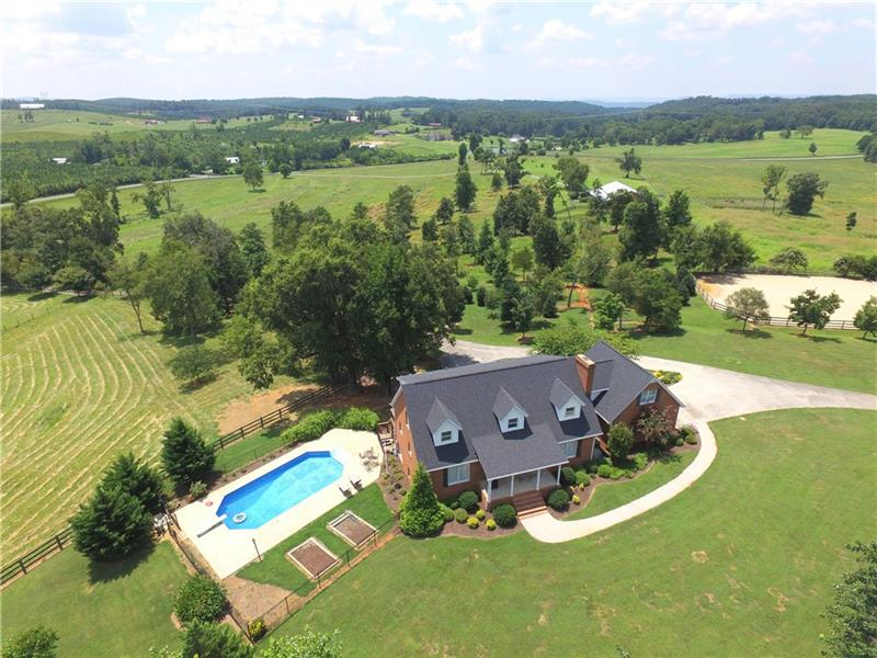 One of a kind Horse Property in Gordon County!  4 sided brick home over full basement with in-ground pool sitting on 14.39 Acres JUST 3.5 miles to I-75.  Regulation Sized Dressage Arena, warm up arena, Brick Horse Barn with all the right amenities to keep your horses safe.  Storage Building for your trailer and equipment.  Several Horse Paddocks.  If you have horses, you do not want to miss this property.  Beautiful Farm and Beautiful Setting!