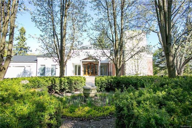 The inspiration of architect Michael Willoughby & perfect execution by TSA Custom Builder combine creating an unparalleled blend of modern lifestyle of this original Edsel Ford cottage. Dramatic elements throughout from the custom metal canopy drawing you into the magnificent foyer featuring a 3 story rotunda lined w metal, glass & art deco. The flowing floor plan incorporates breathtaking views of Wing Lake through original French doors illuminating each room. The 1st floor master overlooks beautiful gardens & connects to the enchanting sun room situated at the heart of the home. Awe-inspiring design at every turn includes plaster details, original wood carved trim, fieldstone fireplaces, & limestone floors. The marvel continues to the lower level featuring a wine cellar, rec area, & work out & media rooms. If a home could reflect a true expression of art & sophistication, this would be it!  Home is accessible via paved roads. Note - part of original home still exits.