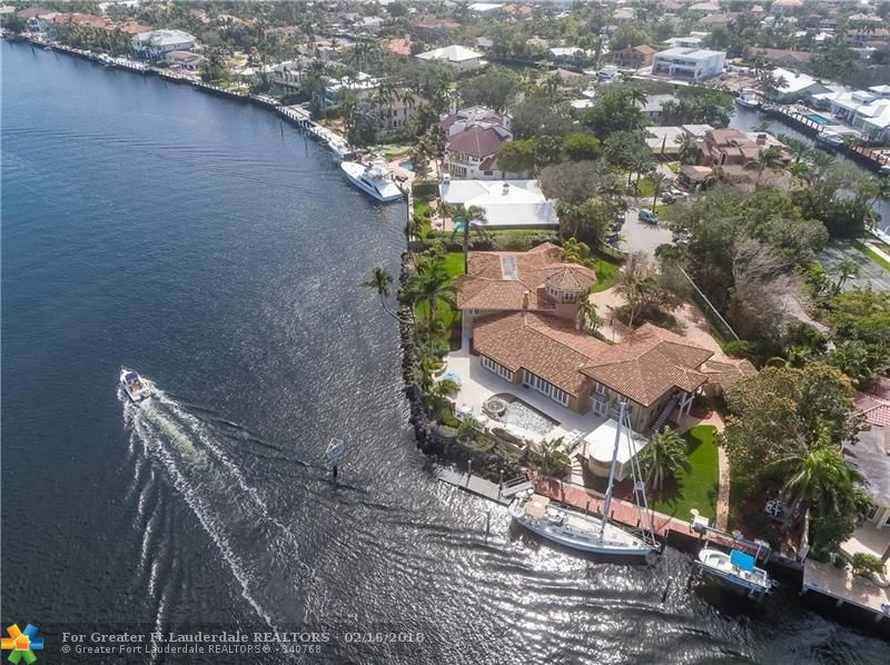 Private & secluded, gated Las Olas point lot estate boasts 315' of deep water frontage on an exceptionally wide canal, protected dockage and breathtaking wide water views from most rooms. Open floor plan w/large chef's kitchen w/butler's pantry, wine cellar, formal living & dining rooms. Master suite with oversized terrace. Downstairs VIP Suite, maid's quarters, media room, study & separate 2BR guesthouse. Generator-impact glass. Guard gated community of Seven Isles. See Broker Remarks for Selling Bonus.