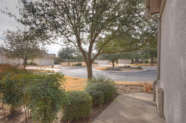 Situated on a lovely cul-de-sac, this Sun City Texas Bayberry Garden home features Lock & Leave lawn care included in the total annual dues.