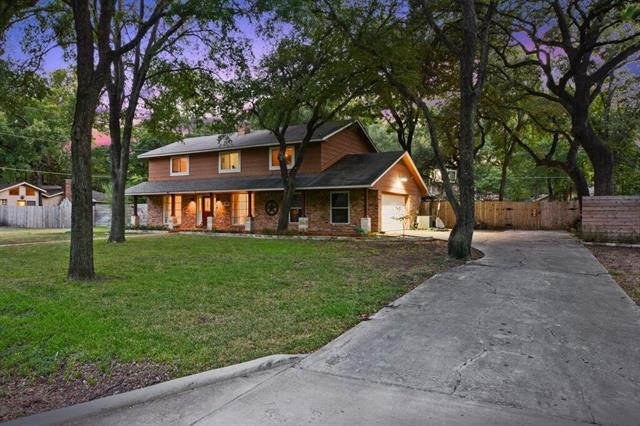 Located in sought after Forest North neighborhood out side of city limits (low Tax Rate)! This Beautiful 4 bedroom 2.1 bath home sits back on huge private lot with No HOA! front porch, Large trees, long drive way. Fire place has been redone, 2 living rooms down stairs & dining. Updated kitchen & windows! Texas sized master, Updated master bath room, &walk-in closet each bedroom is a great size. inviting back yard, with patio, hot tub, lighting & firepit. If you like to entertain this is a home for you!