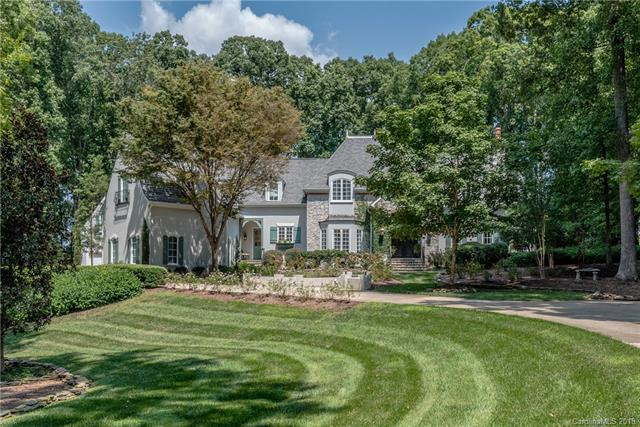 Elegant and beautifully updated, this custom home offers unbelievable curb appeal on 2.35 acres overlooking Longview's 4th Fairway! Features include gated entrance * hard stucco exterior w/stone & brick veneer accents * Foyer chandelier with light lift * FP's & built-in's in Family Room, Great Room & Office * beamed cathedral ceiling in Family Room * MBR on main (luxury bath w/heated floors, 3 custom W/I closets, access to rear covered porch * large Kitchen w/SubZero & 2 wine refrigerators, double ovens, gas range * 5BR's (septic permitted for 4), 4BA's (one Jack-n-Jill) & 2 Powder Rooms * Bonus & Exercise Rooms * Screened Porch w/skylights * Covered Rear Porch w/Flagstone floor * Gazebo w/Hot Tub * Att'd 3-car Garage w/Workshop (cabinetry & epoxy floor) + Det'd 1-car Garage (thermostat controlled) w/storage room above. You'll love the gorgeous grounds and privacy! Home has great natural light! DrapesMounted TV's w/DVDHot TubSono System Int/ExtHome Control System to remain.