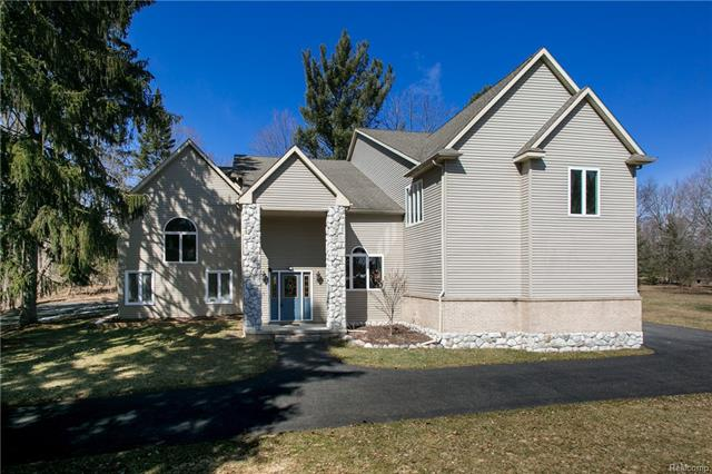 Stunning Departure From The Ordinary! Room to grow w/the extended family w/in-law suite/au-pair suite boasts this 6573 sq ft beauty completely renovated in 2017, $225K in custom upgrades, spacious secluded 1.19 acre wooded lot w/babbling brook for privacy, grand 2 story foyer w/balcony, new flooring, architectural windows, formal dining room, living room, stunning top-of-the-line gourmet kitchen w/custom hood, oversized island, granite, bar sink, custom backsplash, double oven, family room w/doorwall, library, butler's pantry for entertaining, spacious mudroom, oversized laundry, powder room w/custom tile, first floor master suite w/14x10 dream walk-in closet, glamour bath w/custom tile work, separate tub/shower, Euro shower, 35x22 game room w/mini bar, wine rack, princess suite, in-law suite w/sitting area, WIC, Jack & Jill bath, nursey/second office, central vac, the possibilities are endless! Showcased to Perfection! Can't duplicate at this price! Once in a life-time opportunity.