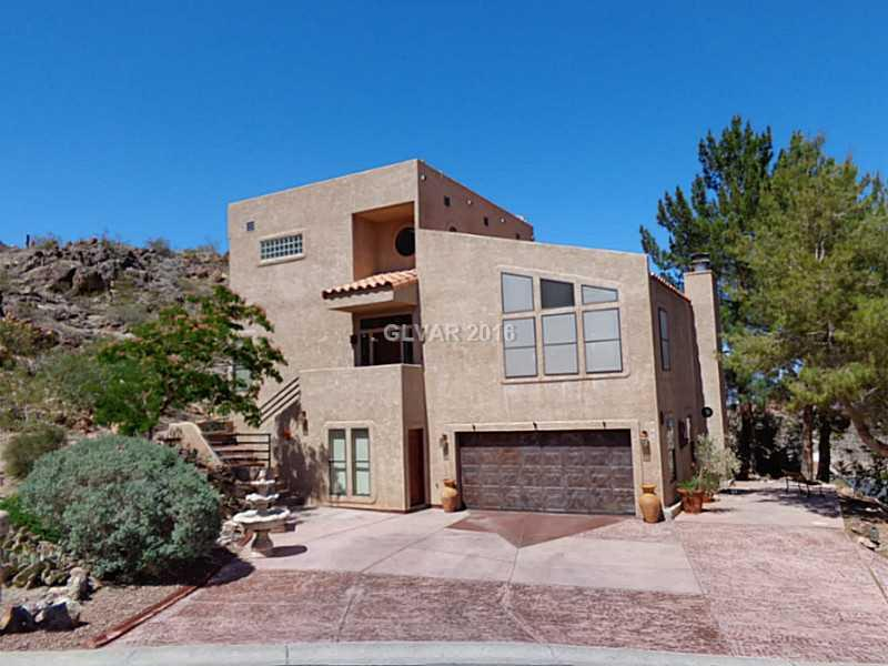 Unique Custom Home w/remarkable Lake and Mountain Views!  Private location  built on the side of the mountain with soaring lake views from all  windows.  Balcony along the back side of the home with built in BBQ center.  Massive master bedroom w/sitting area and balcony.  All Bedrooms have there own bath.  Third bedroom has a separate entry.    Historic Boulder City is known as a clean green oasis in the desert.