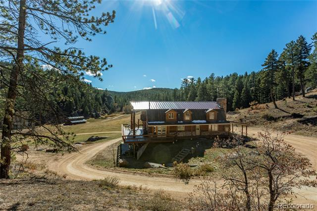 Wooded area, stunning views & rock formations on Bear Creek with a natural spring, ponds, multiple approved wells, quiet private area that is surrounded by national forest land. Log cabin home with a full walkout out basement, wrap around deck with stunning views, bay windows, horse stable/tack room w/loft, 2nd kitchen in the basement, main floor office, slab stone kitchen counters, stainless steel appliances, 1000 gal propane tank, 20k watt back up electrical generator, wood burning fireplace, hardwood floors, security cameras & recording system. A hidden gem with Colorado mountain living but only about 30 minutes from Castle Rock & DTC.