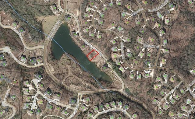 Great Mountain Views comes with this .21 acre Lake Front Property, Bowing Lake, in Gated Carriage Park. The community also has a clubhouse, indoor pool, tennis courts, walking trails, picnic areas and so much more! Minutes from Downtown Hendersonville! Priced below assessed value!