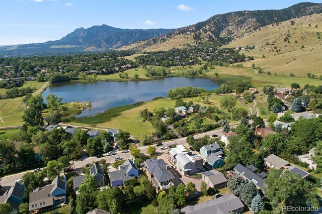Rare find! A one-of-a-kind luxury home with unobstructed views of Wonderland Lake, the mountains, and the Flatirons. Open floor plan with exquisite custom trim and paneling, crown molding, hand scraped walnut floors, gorgeous decks, and more. Elegance abounds. Enjoy the fabulous views and miles of hiking and biking trails just outside your front door.