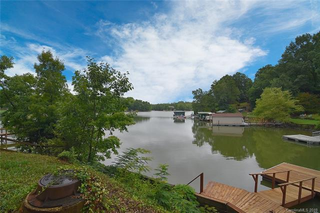 Spectacular view welcomes you from almost every room in the house! You will be in awe of the view as soon as you enter the foyer. Waterfront living at its best on Torrence Creek cove over looking Lake Wylie. Updated kitchen with Thermador cooktop and lots of storage.  Spacious Master on main. Total 3 Bedrooms/2 Baths on main level. Ranch w walk out basement features great/rec room, fireplace, 4th bedroom, 3rd bath & storage galore. Open floor plan and decks are perfect for entertaining. Private dock w boat and jet ski lift. Low maintenance yard, perfect to enjoy   lake living at its best. Tega Cay vacation lifestyle! Fort Mill schools.