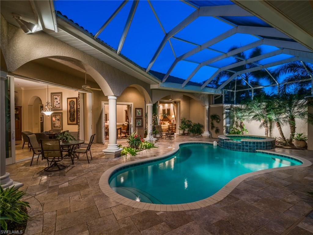 Enter your home through the tropical serene courtyard welcoming visitors to the epitome of Florida Lifestyle.