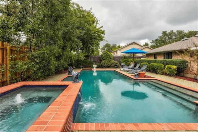 Beautiful Single Story 4/2 on Large Lot~New Stainless Steel Appliances & Granite Countertops in Kitchen~Plantation Shutters Throughout Home~Great Family Room with Vaulted Ceilings & Stone Fireplace~Pella Windows~Large Master Bath with Lots of Storage & Granite Counters~Oversized Covered Patio Overlooks Gorgeous Pool & Spa~Pool Resurfaced w/ Caribbean Blue Pebble Finish~Replaced Pool/Spa Heater~Replaced Pool Filter System & Pump~Tens of Thousands $$ in Upgrades~See List of Upgrades For More!!