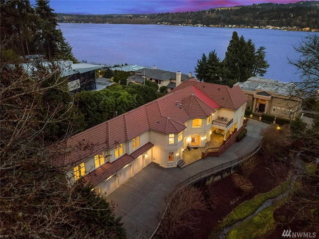 Welcome home to traditional elegance on a private 2 acre estate w/ lake views. Dramatic foyer w/ dual staircases welcomes you to 7,380SF of luxury. All 5 BDRs are en suite, custom millwork & an ideal blend of formal & informal spaces. Features include guest quarters, home theatre, 5 fireplaces, 4 car garage. Smart systems & high-end amenities:Leviton home automation;Crestron A/V;Sub Zero, Miele& Bosch appliances. Award winning schools& easy commute! The BEST value on Mercer Island!