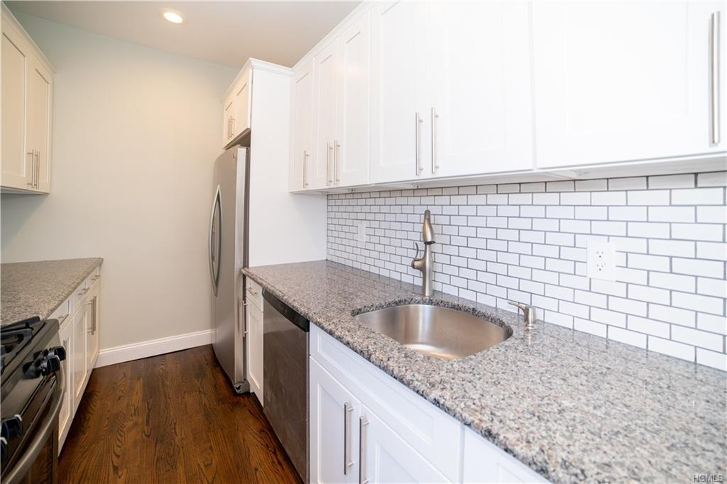 Elegantly appointed at Bronxville Terrace. Nothing left undone, high ceilings and archways characteristic of a charming pre-war building show well in this fully renovated apartment. Recessed lighting, eat in kitchen with dine in counter and a deep stainless sink. This sunny top floor unit features granite countertops, stainless steel appliances including a convection range , microwave oven, and dishwasher. Custom white soft closure cabinetry and custom light fixtures. Brand new oak flooring throughout with jaco bean stain throughout and a tastefully renovated bathroom. Abundant storage including cedar closet in MBR. Ceiling fans in living room and bedrooms. New electrical and plumbing. Close to all, 30 minutes to Grand Central from the Metro North (just 7 minutes walk from the building). Walking distance to Village of Bronxville. Easy access to major highways. Outdoor space available for grilling and gym access available. Will not last.