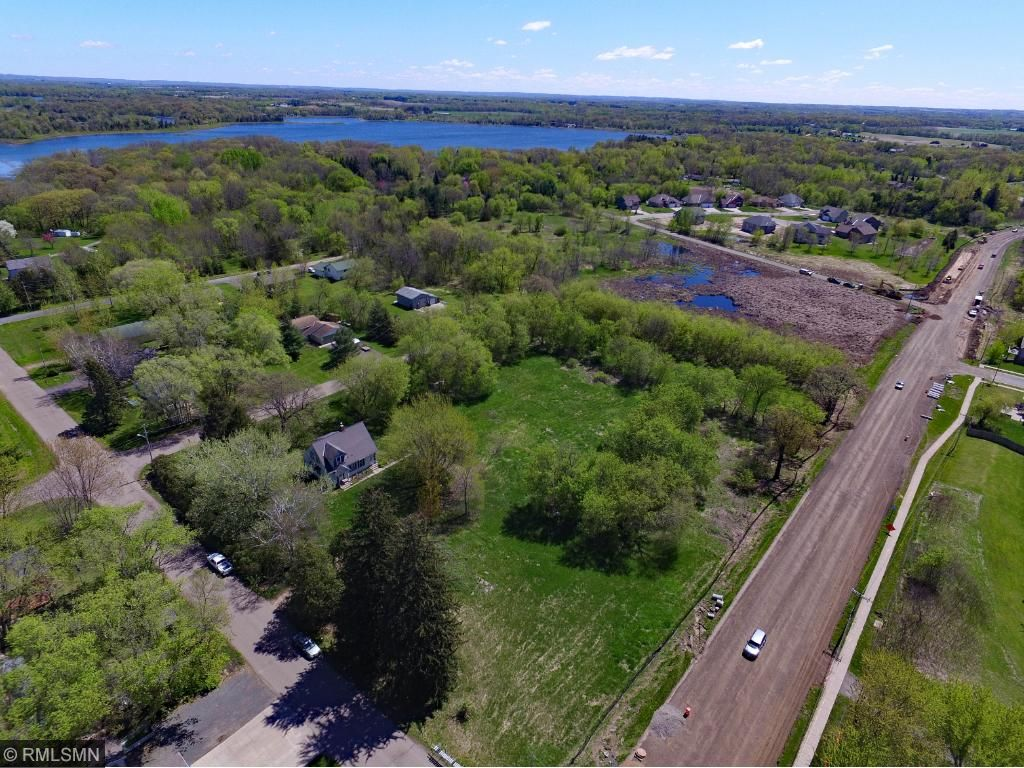 Great location in Chisago City in between Green & Chisago Lakes. On bike trail, close to senior services, city water & sewer in street. Old farm house has water & sewer, 3 PID's can be sold separately, or subdivided. Apx 2.5 acres wetland.