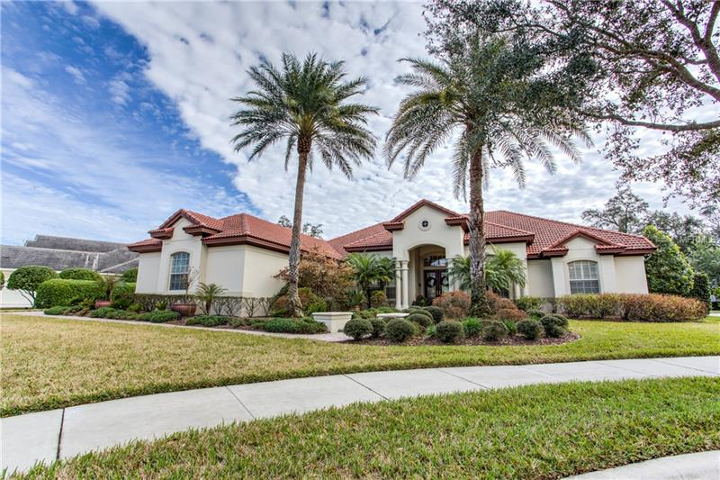 """Welcome home to your professionally designed, one story waterfront pool home located at the end of the cul-de-sac in the beautiful Alaqua Lakes community. With 4 bedrooms, 4 baths, dedicated office, generous living space and stylish finishes, you'll enjoy a perfect setting for relaxing and entertaining in this 24 hour manned gated golf-front community. This """"Salerno"""" floorpan home features a three-way bedroom layout that includes a full guest suite with its own living room, full bath and large bedroom. Special highlights in the home include coffered and tray ceilings, plantation shutters, crown molding and two sets of stacking sliding glass doors leading to the gas grill and pool. The gourmet kitchen will inspire your inner chef with its stone counters, modern cabinetry, and GE stainless steel appliances. The owner's suite offers respite at the end of the day with a dedicated sitting area, an impressive walk-in closet, dual vanity areas, a Jacuzzi tub and perfectly tiled stand-up shower. Long brick paver drive to the side-entry three car garage, mature landscaping and a screened-in pool give you all the privacy or entertaining space desired. Water views from all entertaining areas, gas fireplace, and custom built-in bunkbeds for those neighborhood sleepovers make this house a home. Alaqua Lakes, home to the Legacy Golf course, is a natural gas neighborhood that features a park, pool, tennis courts, a basketball court and is minutes to local shopping and restaurants. Call today for your private showing."""