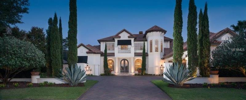 Surround yourself w/sophistication in this impeccably designed 7,200sf TURNKEY premier residence in Alaqua Lakes on Legacy Golf Club's 8th fairway. Tucked inside double gated 'ENCLAVE' featuring 6 En-suite bedrms, 8 baths, dual home offices, Mancave, Theatre Room, 2 bonus rms, craft/laundry rm, 2 Butler pantries, expansive pool w/copper fire bowls, 2 covered travertine loggia & a 4-car oversized garage w/addtl parkg for 5 vehicles! Fine details include Venetian plastered handcrafted walls, marble flooring w/custom inlays, stone finishes, tailored millwork, hand painted antique gold & silver leaf finishes by Patrick Daly; imported light fixtures, custom silk draperies, Sinker cypress T&G ceiling detail, Walker Zanger stacked stone & glass w/mosaic tile detail, 2 stone fireplaces; a man's room accented w/pecky cypress doors, beams, 2 built in gun cabinets, leather benches, Blatt pool table, 3 mounted TV's, custom plantation shutters & Cigar Patio; A winding staircase leads to 2nd floor w/bonus rm, kitchenette, Theatre rm, 3 bedrms & 3 baths. Loaded kitchen w/DACOR, SUBZERO & MIELE appliances, 6 burner gas cooktop, 4 ovens, 2 dishwashers, 3 disposals, 2 built in refrigerators, 3 bev/wine refrigerators, soapstone island, marble/stone countertops & a fabulous hidden pantry! Extensive hardscape pkg custom designed by Dix Latrop  creates an amenity-rich residence beyond copper glass lanterns. Reward yourself w/luxury when ONLY the best will do! This property may be under video/audio surveillance.