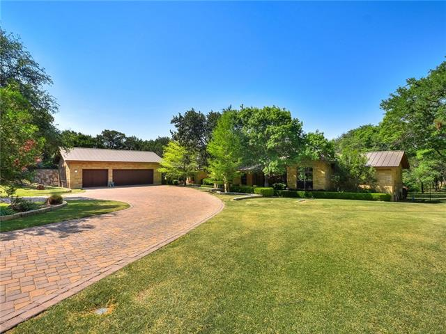 Custom built Hill Country contemporary style home on private 1.38ac lot in gated community. Mostly one story home- 4073sqft first floor w/ Master + 2 bedrooms each w/ full bath, Office/study & game room. 799sqft upstairs w/ bedroom+full bath + flex room that could be bedroom or a game/media/office w/wet bar.  Private backyard w/ room for pool & lots of space to play. Home also features a temperature-controlled wine cellar w/ storage capacity for over 150 bottles of wine.