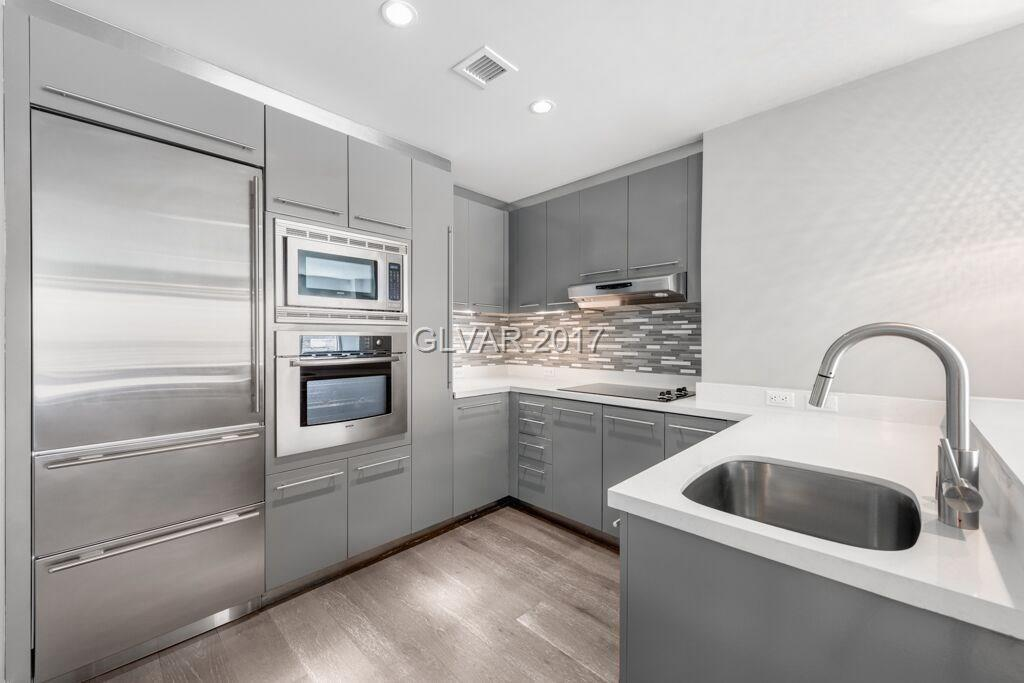 Sky developer unit located on the 25th floor. This split 2 bed 2 bath floor plan has views of the Las Vegas Strip,  City & Red Rock Mountain views. Newly renovated with new kitchen counter tops, cabinet treatments, engineered wood flooring, upgraded carpet & lighting. Former Model.