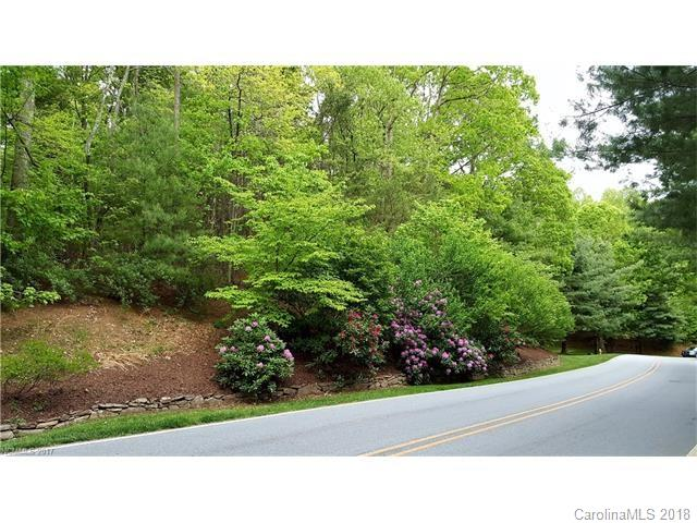 Looking for an extraordinary place to build that perfect Blue Ridge Mountain home? Take a look at this very affordable, gently sloping wooded lot across from the 6th fairway of the #11 North Carolina ranked Champion Hills Golf Course, designed by Tom Fazio. Enjoy living in a member-owned & debt-free community! Priced well below tax value and centrally located to all the community amenities. 10 minutes to beautiful Historic Downtown Hendersonville's shopping, dining and entertainment.