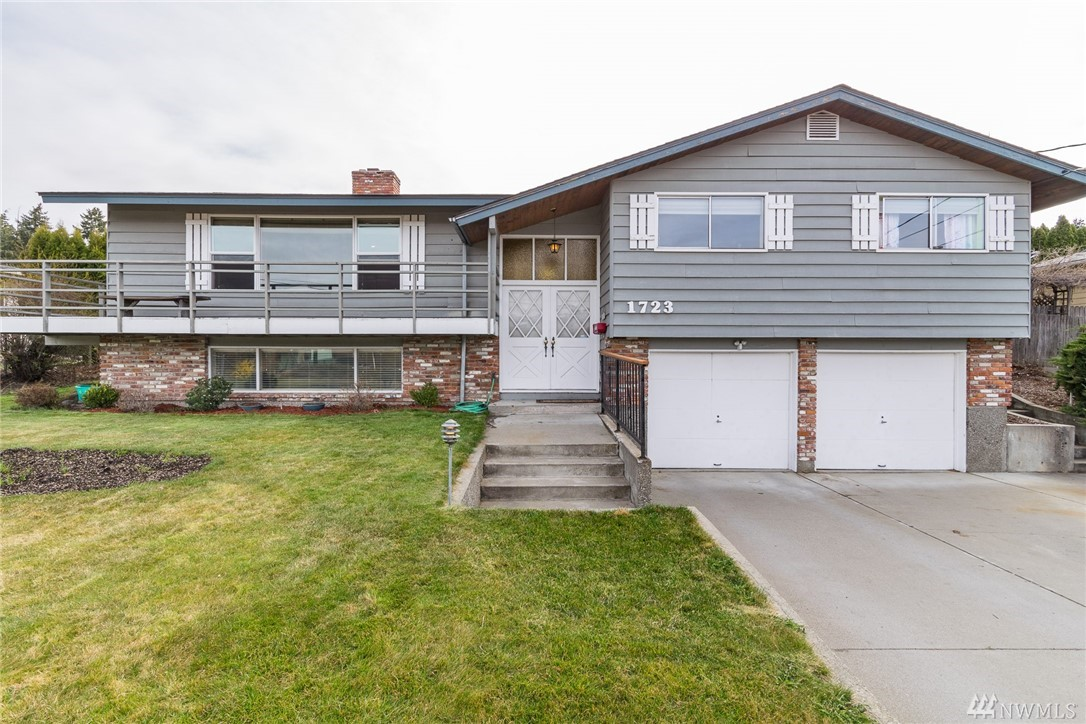 Larger split-level home with views of picturesque Cascade Mountains and room for RV or boat parking. Over 2400 sq. ft., 2 car attached garage, with fenced back yard, and large front deck. Large extra room previously used as a bedroom (county shows as a 4-bedroom), a half bath, and access to the garage downstairs. Two fireplaces also built in pizza oven built into back of fireplace. Mature landscaping, storage shed, and many lighting upgrades throughout the home. Won't last long at this price.