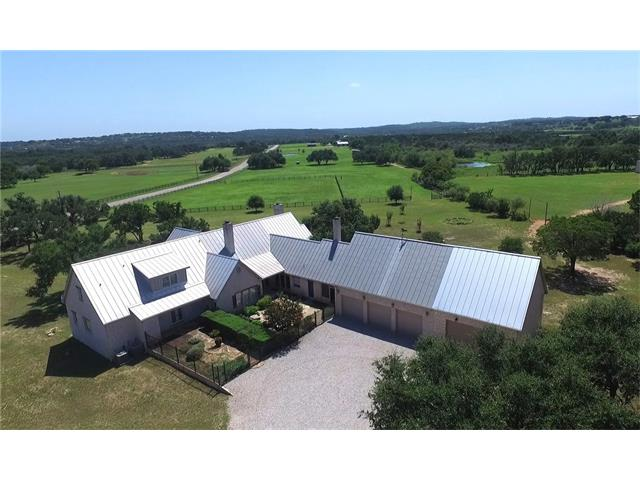 Incredible hill country estate. Residence, get-away, entertainment.  Beautiful spacious main home, ideal everyday accommodations for family and guests.  17 acres of green pastures with pond, extensive improvements, oversized garages, workshops, equipment barn, cattle barn w/pens.  Privately located in the gated The Place on Lake Travis with nearby executive airport, LCRA lakefront parks, and BC Lakeside Club and Golf.  Convenient to the many amenities of The Hill Country Galleria in Bee Cave and Austin.