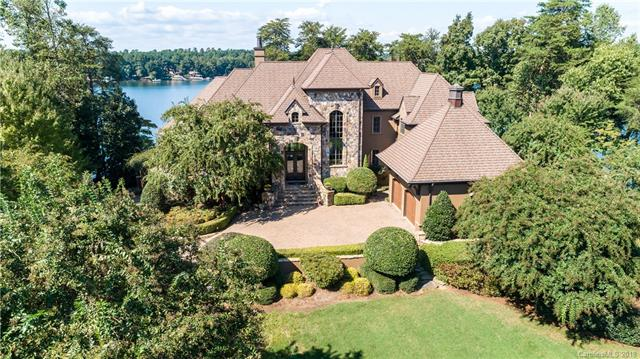Exquisite Waterfront Estate, spectacular water views, & 389 ft of shoreline. Key features = 9066 sq. ft, 5bedroom, 5 full bathrooms & 2 ½ bathrooms, 4 car garage, heated salt water pool, elevator, 680 bottle wine room, 3 laundry areas (one in master suite), 1.12 acres, media room, sauna, 2 offices, full 2nd full/kitchen at lake level.Each bedroom has its own bathroom, huge private pier with dock & so much more in this one of kind trueestate. The floor plan is shown in the photos. PLEASE WATCH THE DRONE VIDEO TO SEE HOW AMAZINGTHIS HOME REALLY IS.  Contact Sandy for questions & offers.