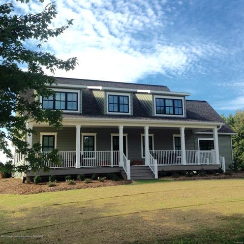 This HGTV inspired custom 2-Story Modern Farmhouse was built in 2016 and has almost 4,000 sf of Living Space.  This home has a mix of contemporary designs, custom 1950's era plaster cove ceilings and Victorian era pocket doors. First floor Master Suite has 15 x 14 bedroom, separate den, custom closets, heated ceramic floors in bathroom, freestanding soaking tub and ceramic tile shower. The spacious kitchen is a Chef's dream. Home includes an Elevator servicing 3 floors. Upper Level of home has 2 large bedrooms, an additional Flex room bring used as a 4th bedroom, 3 lofts and a 29 x 16 media/bonus room. Outdoor has a Zen Garden, Hay Barn, Equipment Building, Heated Workshop with loft, 1/2 bath, Radiant Floors-perfect for Master Hobbyists, Car Enthusiasts.