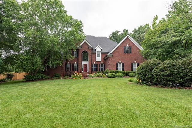 Welcome home to this completely custom full brick move in ready home in desirable Ashe Plantation. Home boasts tons of space inside and almost 2 level acres with mature landscaping outside. Home also features five gigantic bedrooms and 7 walk-in closets; 2 with custom cabinetry. Main level dedicated office with french door access. Kitchen has stainless steel appliances. Downstairs owners retreat w/ sitting area & tray ceilings. 400 sq/ft bonus room w/ second stairway access. Main floor has hardwood floors in all rooms except master & mud. Huge mud room has new laminate floors and built-in cabinets. Many upgraded features including 2 new Trane AC units valued at over $15,000, Leaf Filter gutters, new garage door system, all new smoke detectors, fresh paint in much of home, upgraded baths upstairs and extended decking off large patio. Transitional floor plan offers the perfect flow for entertaining small or large gatherings with an intimate feel. What are you waiting for. Come see today.