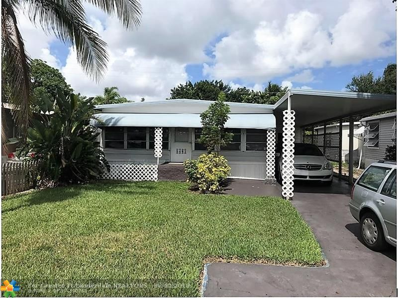Absolutely gorgeous  2/2 doublewide - carport -shed - enclosed patio area - -central a/c - beautiful floors throughout - -no rear neighbor - - oversized lot - -priced right for quick sale - -truly a must see.