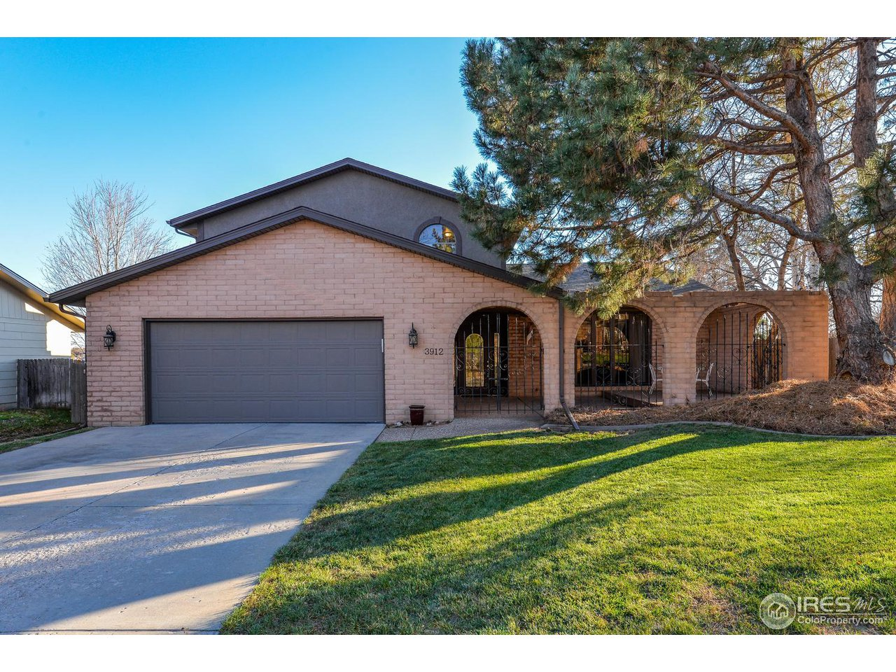 COME SEE this gorgeous home that backs to OPEN SPACE and sits in a quiet neighborhood! Enjoy the relaxing gated courtyard out front, and watch beautiful Colorado sunsets from your very own private balcony directly off the master bedroom. NEW roof, new gutters, new water tank-less water heater, new furnace, granite counter tops, and luxury 5-piece master bath. NO HOA. Additional basement living area has separate entrance. Could be a rental!