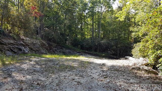 This lot is -- without question -- the best-priced parcel in a Highlands country club! Already cleared and ready for you to begin building, this .60 +-/ site has paved, gentle access inside the gates at Wildcat Cliffs Country Club. Owners have a full set of plans drawn by local architect, Sam Edgens, that they are willing to sell at a bargain price. Don't delay! This site is ideal for you to begin enjoying country club living in one of the South's most desirable clubs -- at a price you won't see again.