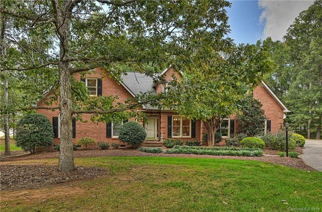 A unique opportunity to own a stunning brick home w/ a huge detached garage/workshop on over 5 acres not far from Mint Hill, Matthews, & 485!  Perfect for reunions, gatherings or car enthusiasts! On a beautiful lot w/ mature trees, a patio, koi pond, & a waterfall, this home has gleaming hardwoods on the main & upper floors & tile in all the baths. It offers great spaces for gathering in the formal DR & in the great room open to the breakfast room, sunroom & kitchen featuring a breakfast bar & two ovens, including a Jenn-Air!  Main floor is complete w/ an owner's suite plus two bedrooms & a hall bath.  The second floor is spacious w/ two bedrooms separated by a shared bathroom, a huge bonus room, an office/music room, a rec/hobby room, a half bath & storage areas. 2,737 addtl. heated square feet in the detached 4 car garage w/ kitchen, fireplace, full bath & bonus room above is a super workshop/entertaining space w/ a covered porch, built-in BBQ oven, & a huge driveway/parking pad!