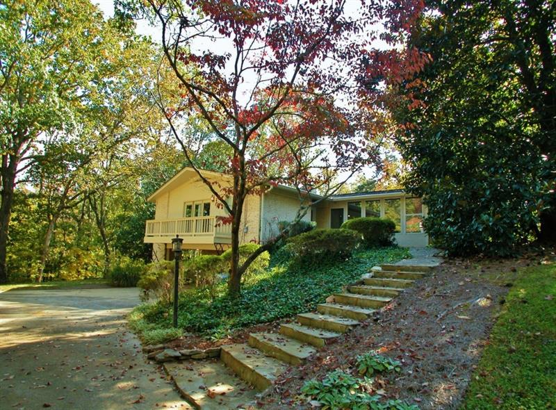 Great retirement home for sale in edge of N GA Mountains. World class medical care 3 miles away. Ground level access to both floors with driveways. Convenient to Lake Lanier parks and boat ramps. Dog park nearby. Entertaining patio with fire pit, outdoor deck, media room, 2 solariums. Atlanta Botanical Gardens 1 mile. Gardeners delight with sprinkler system & 1 acre =/- with mature landscaping. Separate well & pump for irrigation. City water, natural gas, with grill hookup installed. Two gas fireplaces. Convenient to international airport Atlanta & shopping.