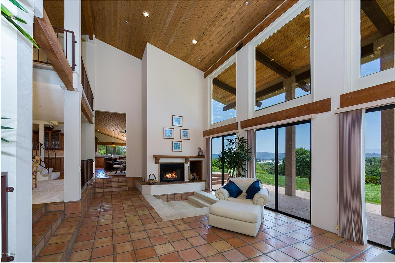 Located on a private knoll in Somis, this beautiful 3,980 sq ft custom home takes full advantage of the countryside views. Dramatic two story floor-to-ceiling windows capture 180 degrees of greebelt orchards, equestrian ranches and Santa Monica Mountains beyond. The home's remodeled gourmet kitchen includes granite counters, double convection ovens, walk-in pantry, and large central island with five burner gas range. High vaulted wood-plank ceilings, two-story pillars and solid wood doorway beams enhance the home's unique architectural elements. Rich Saltillo tiles run almost the full length of the ground floor, extending outside to the backyard patio with fountain. All three bedrooms are located on the first floor, with the second story designed as a large open loft. The two acre property includes several dozen avocado trees. The gated driveway leads uphill to the three car garage with direct home access.