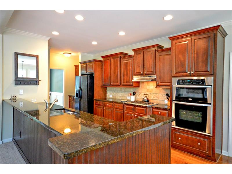 Enormous granite countertop space in this updated kitchen.  Stainless kitchen appliances and hardwood floors.
